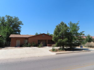 Front view of circular driveway and trees of Home for Sale 721 Washington, Grants, NM 87020
